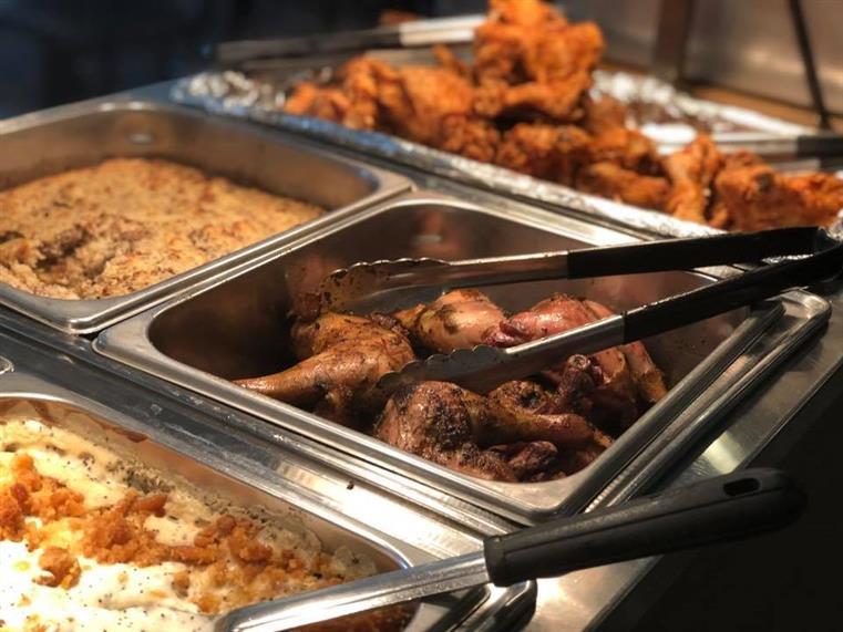 catering buffet display of fried chicken and mashed potatoes