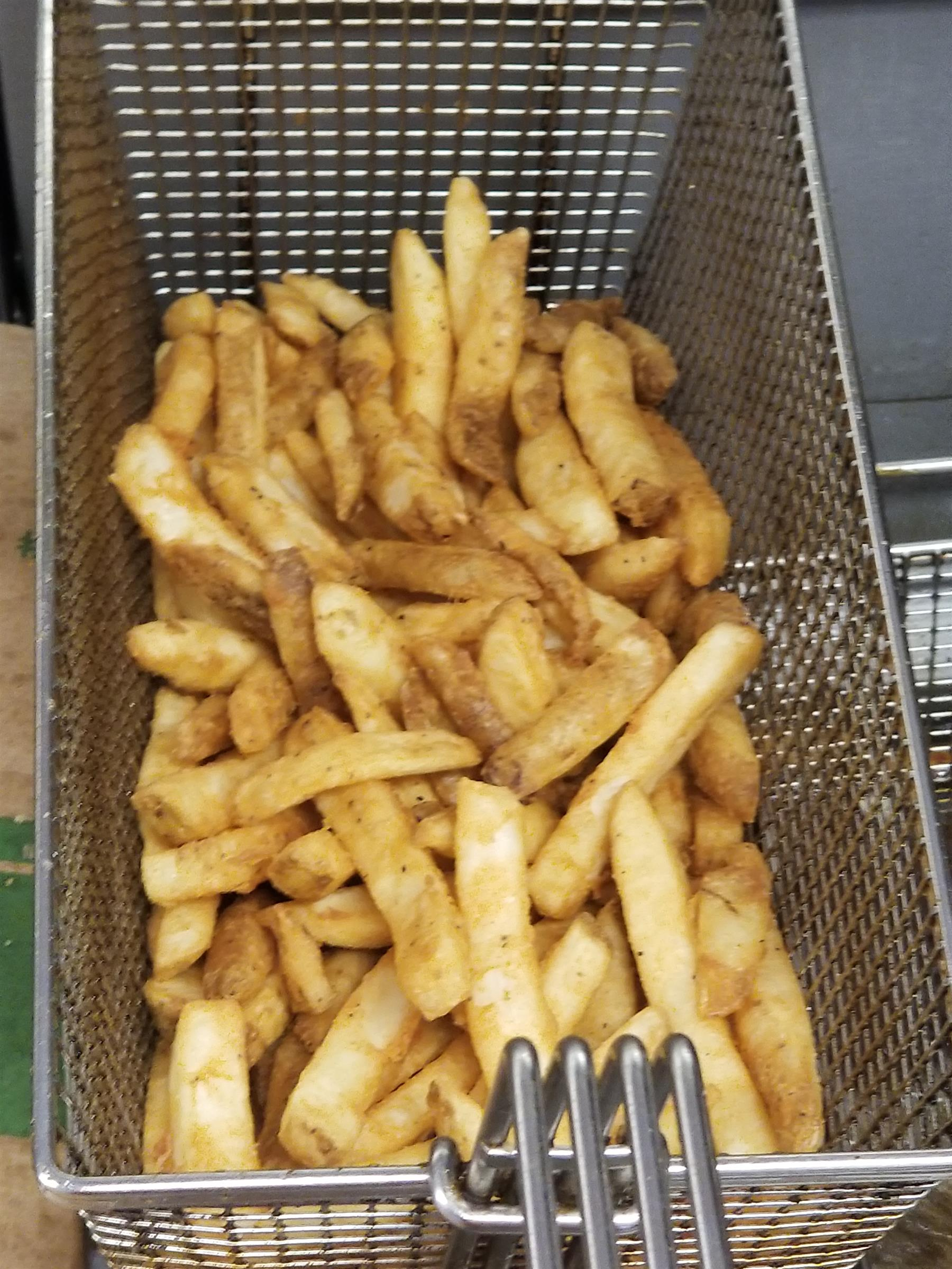 Fries in deep fryer basket