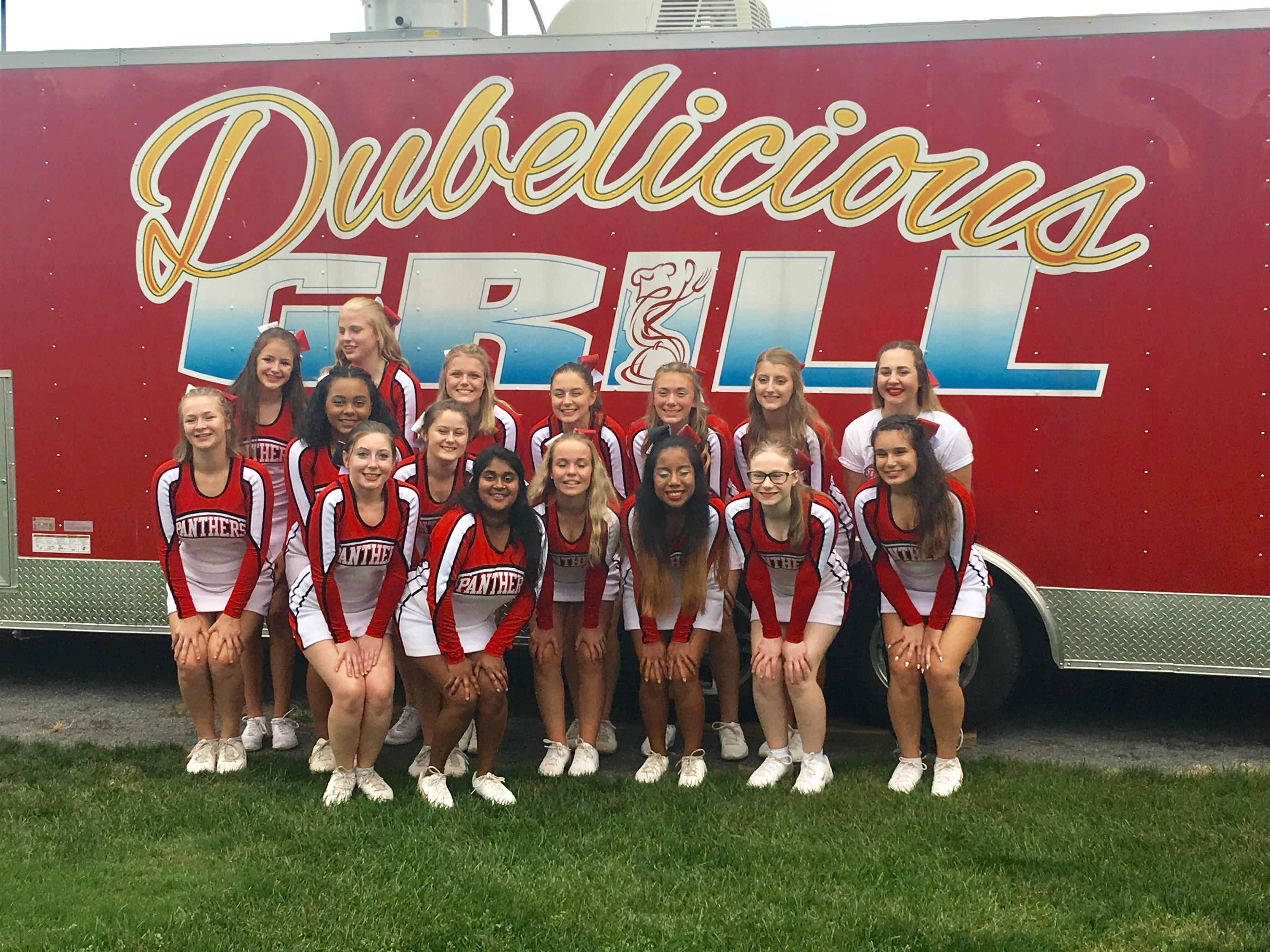 Cheerleading team outside of dubelicious grille truck