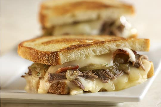beef, melted cheese, peppers and onions on toasted bread