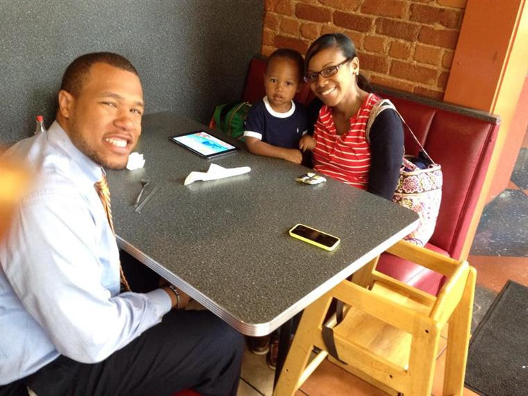 happy family sitting at booth inside humbs up diner