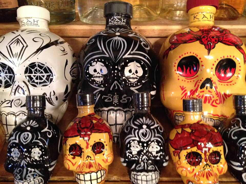 An assortment of painted skull tequila bottles