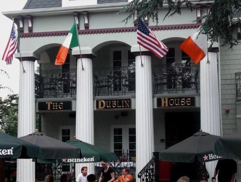 exterior view of store front with irish and american flags