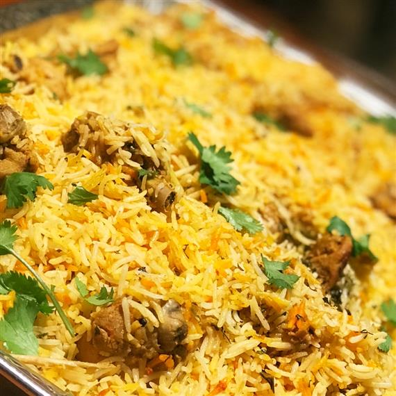 yellow rice with meat and cilantro