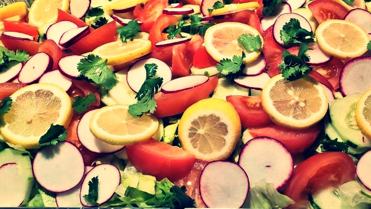 salad with cilantro, lemons, tomatoes, and radishes