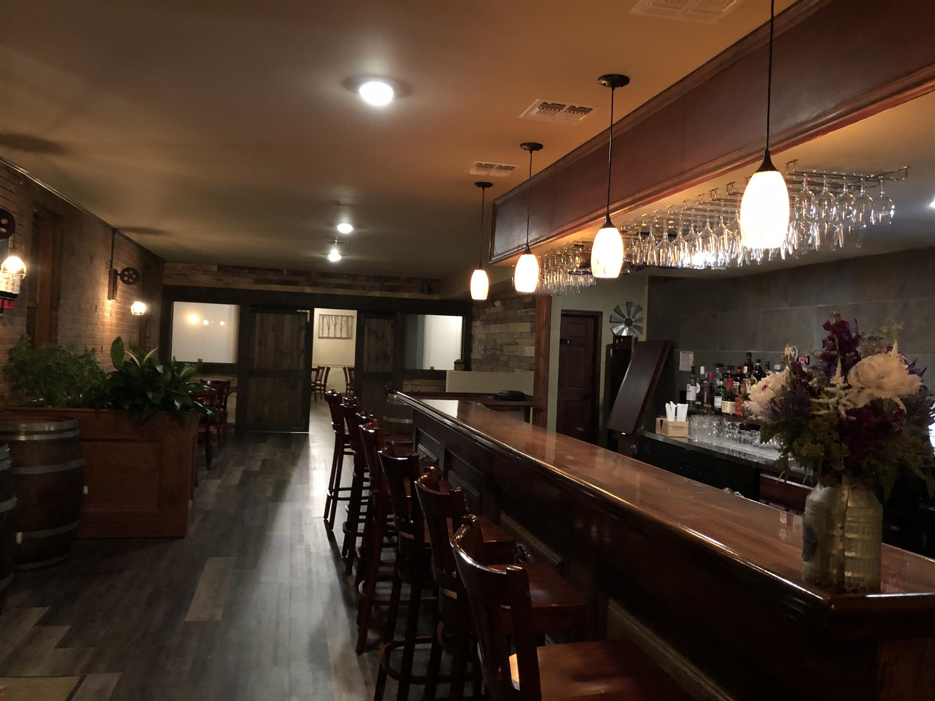 dark wood mahagony bar with rustic lights and brick walls