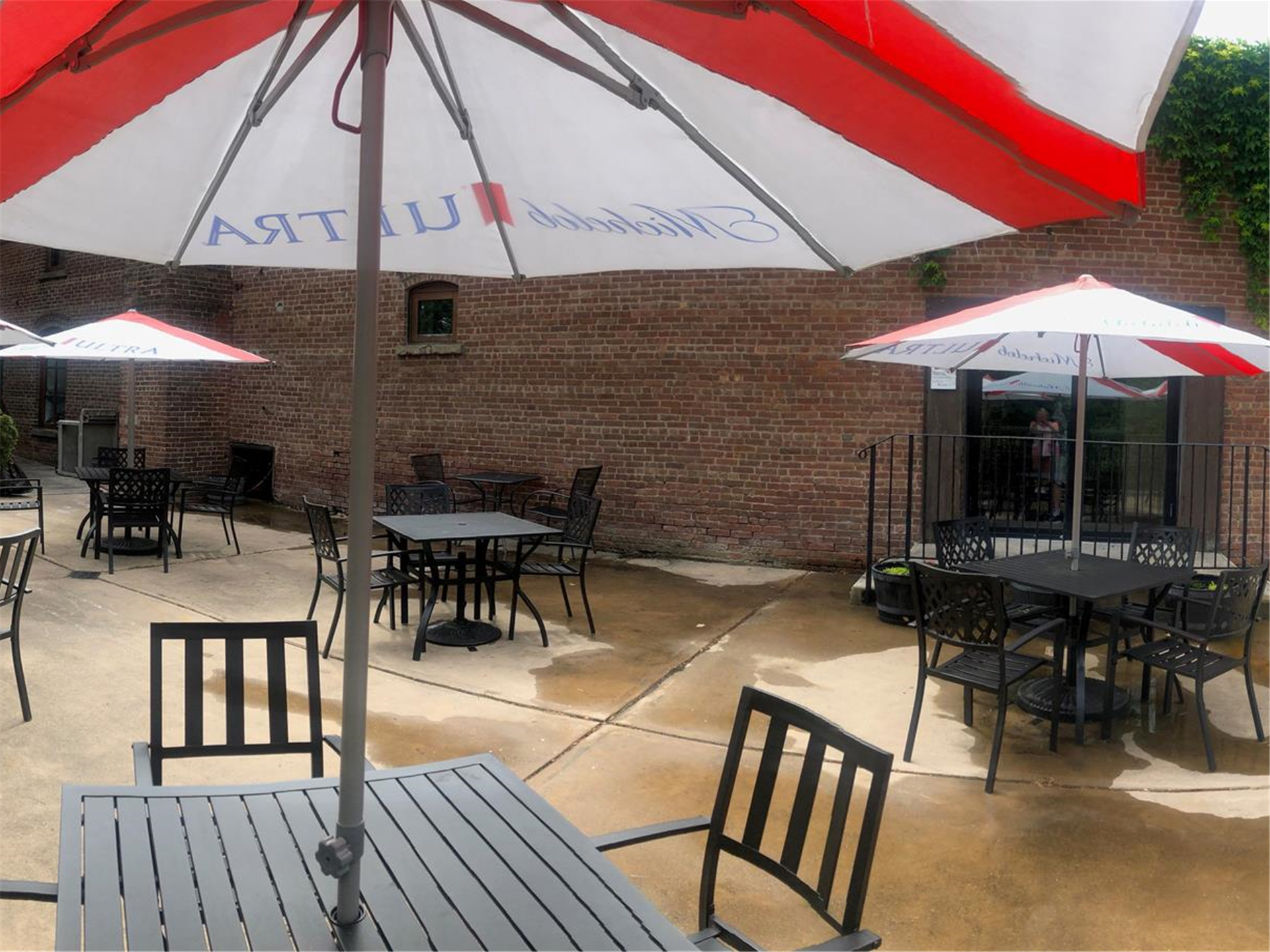 outside dining tables with umbrellas