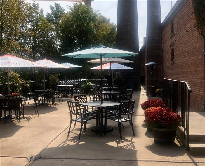 Outdoor patio area. Tables and chairs with umbrellas