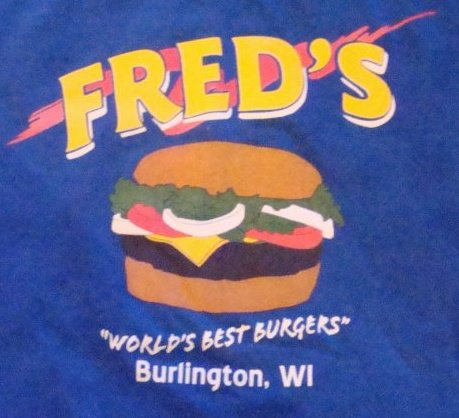 Fred's Burgers branding on a t-shirt