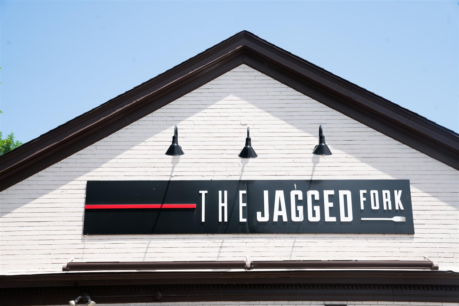 The Jagged Fork logo on a sign on the storefront