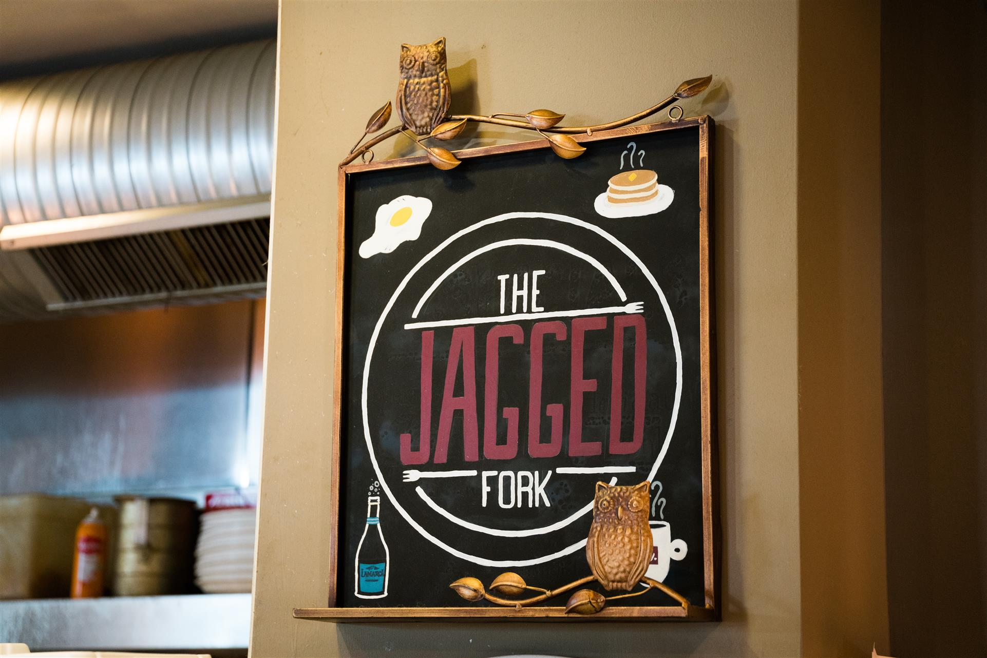 the jagged fork sign on the wall