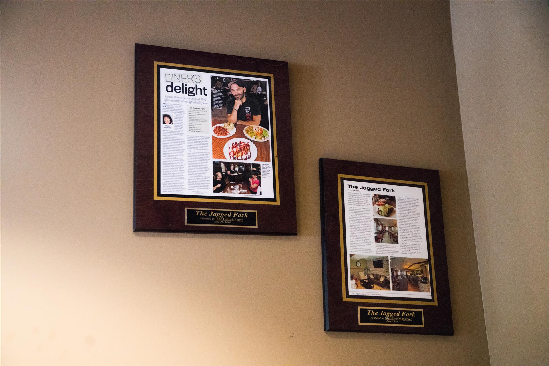 the jagged fork's features in newspapers and magazines hung on the wall