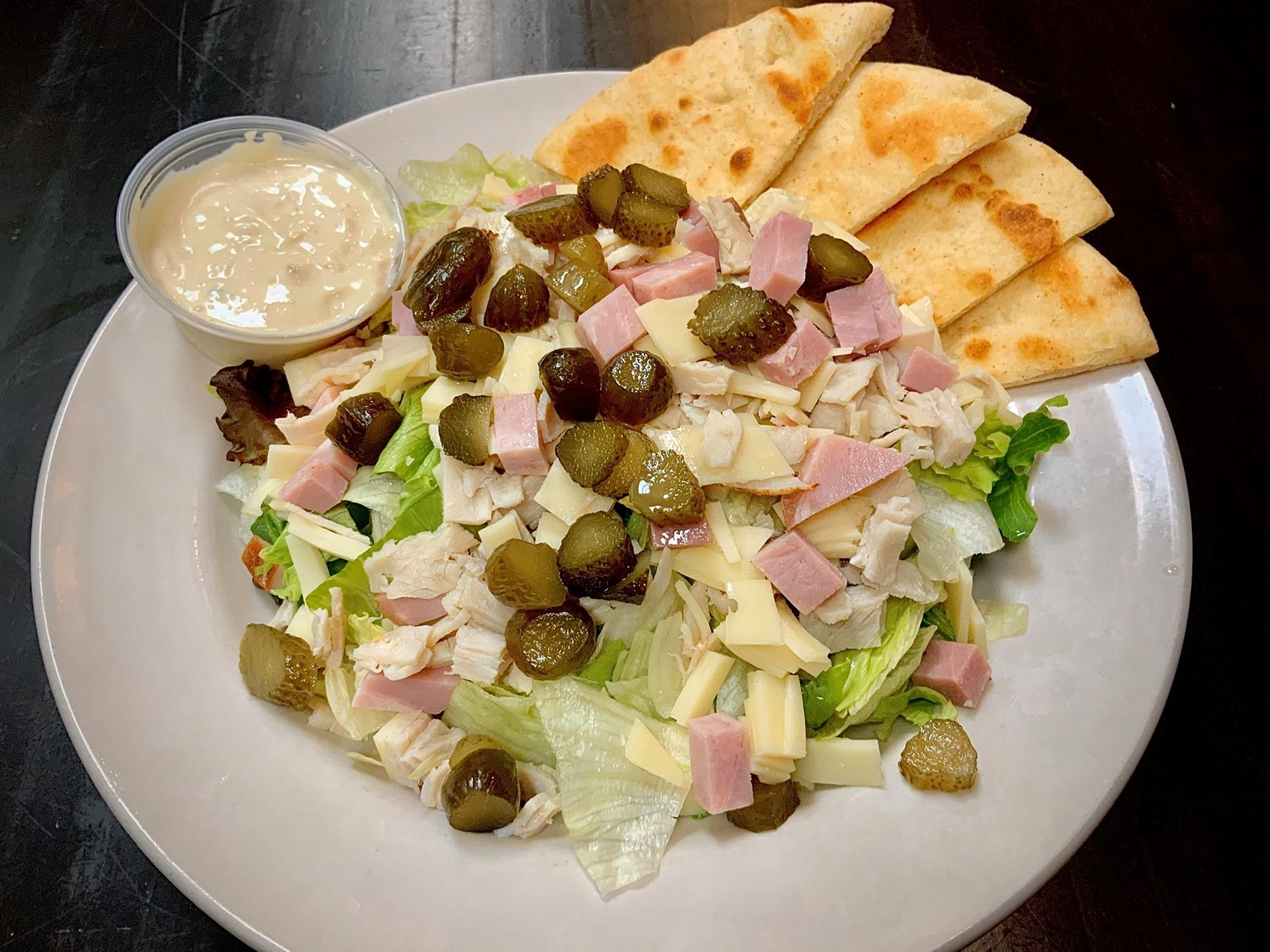 Hudson Salad: Chopped Iceberg, Chopped Ham, Turkey, And Natural Swiss Cheese, Gherkin Pickles And Served With Our Homemade Maurice Dressing On The Side