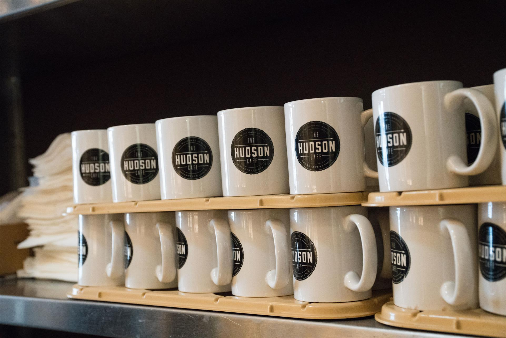 stacked mugs with the hudson cafe logo