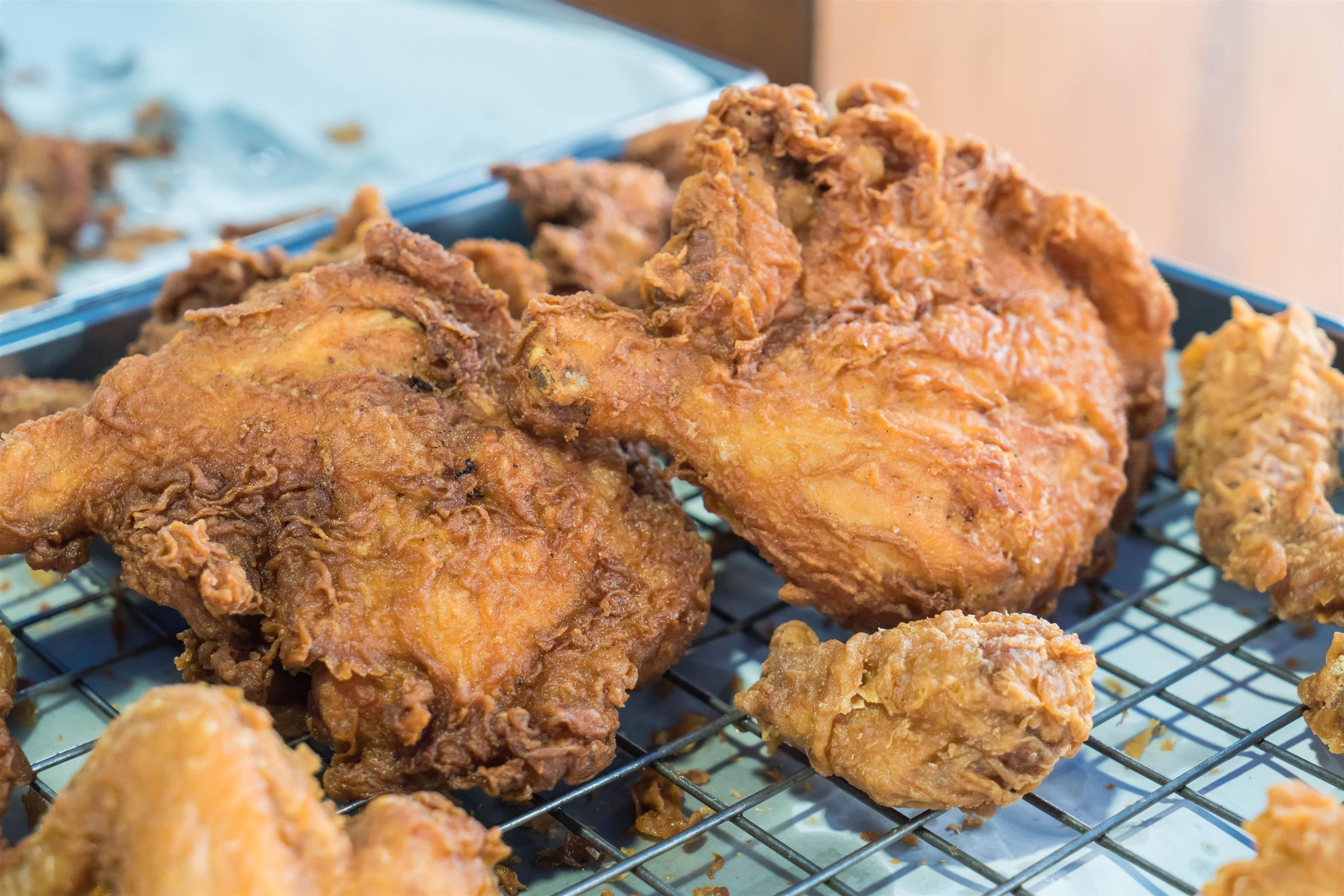 Crispy fried chicken on a baking rack