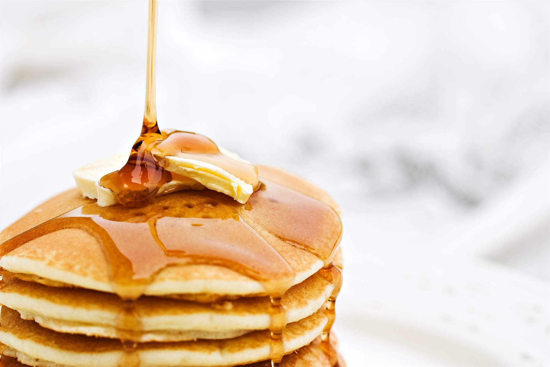 stack of pancakes topped with butter and pancakes