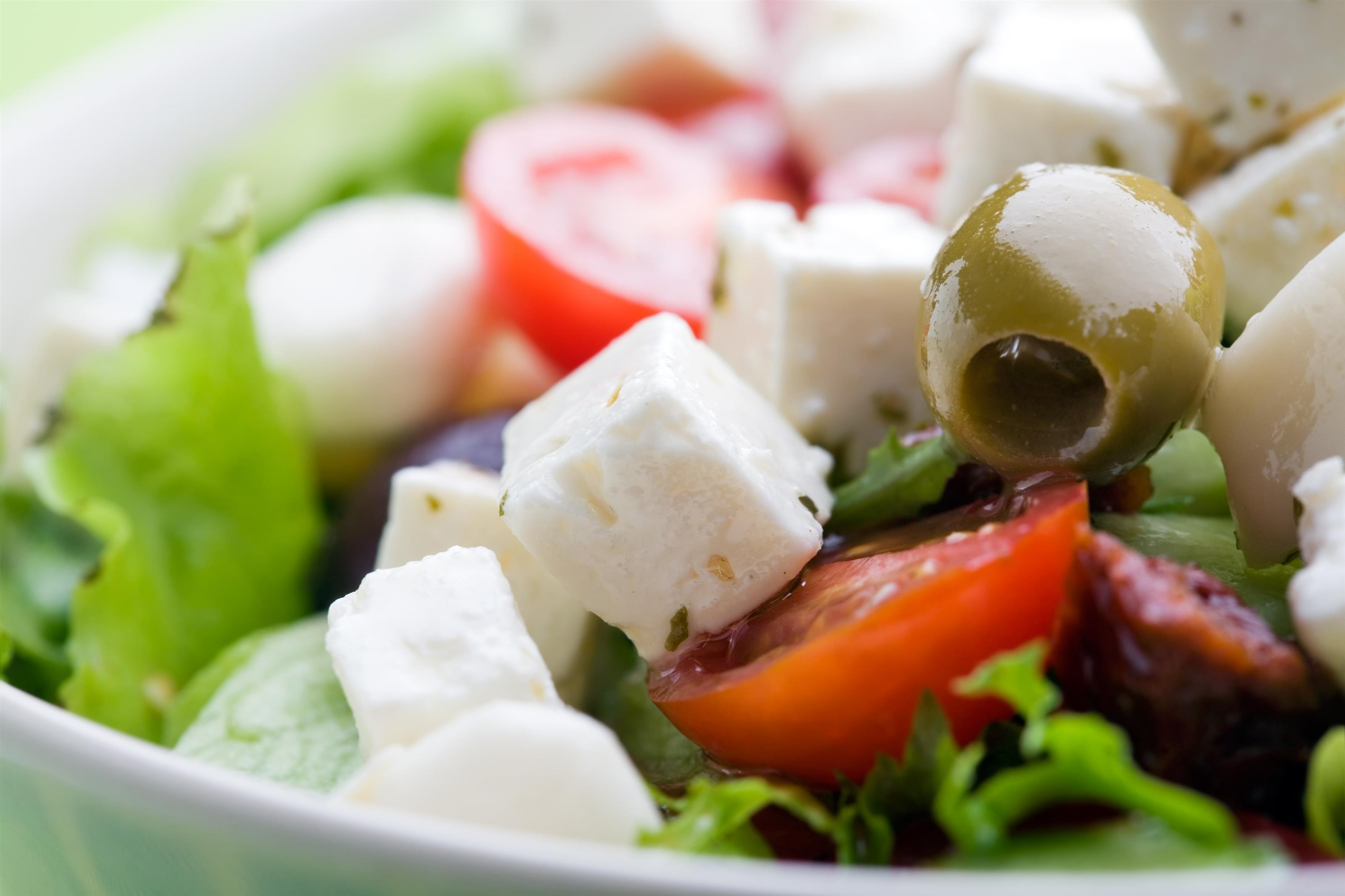 fresh salad with feta cheese, tomatoes, olives and vinaigrette dressing