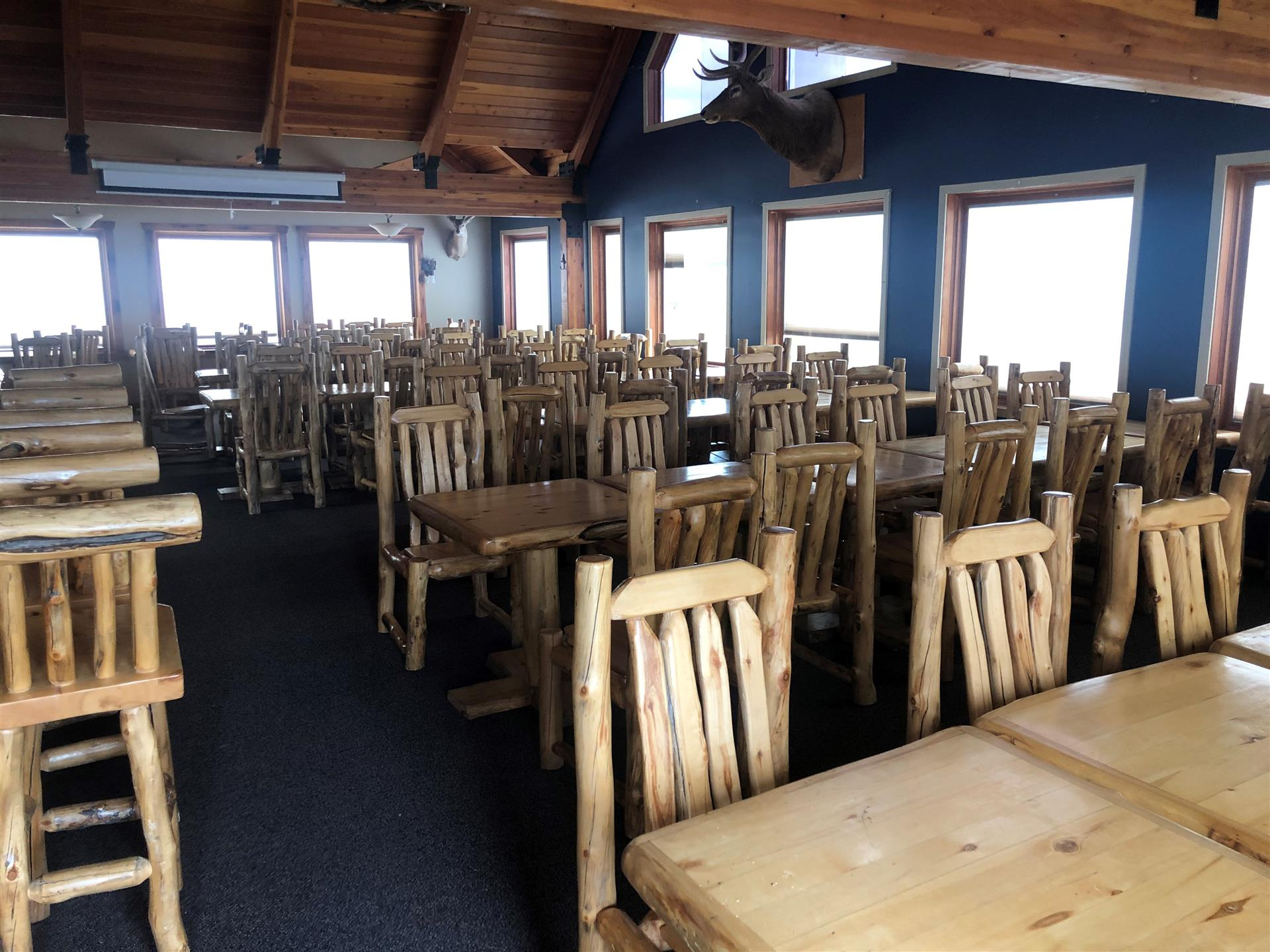 a room with wooden tables and wooden chairs