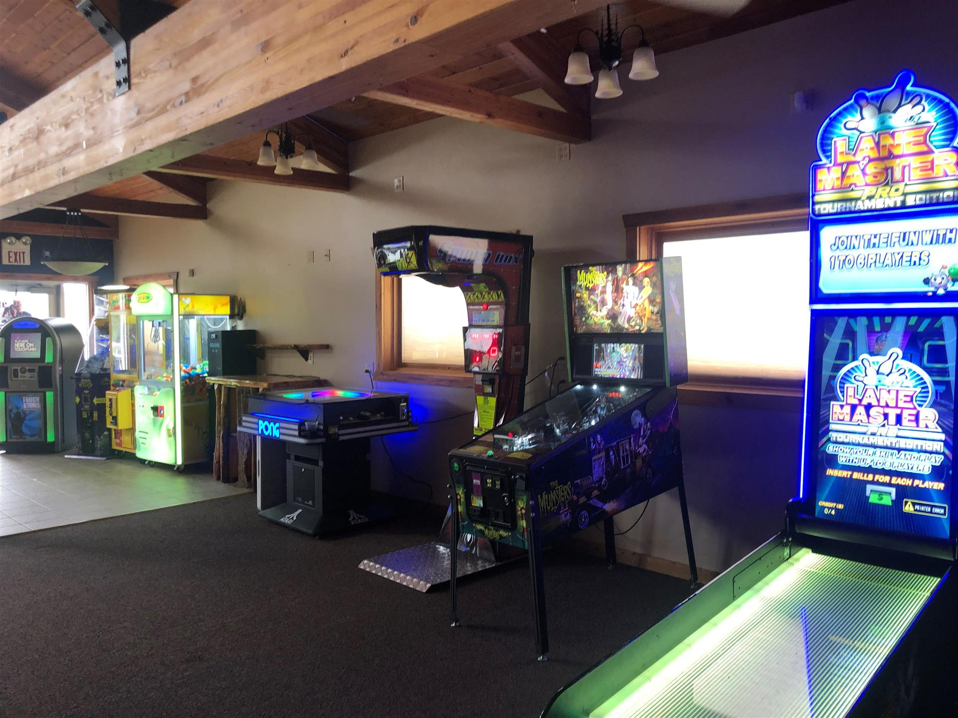 multiple arcade games in an open room