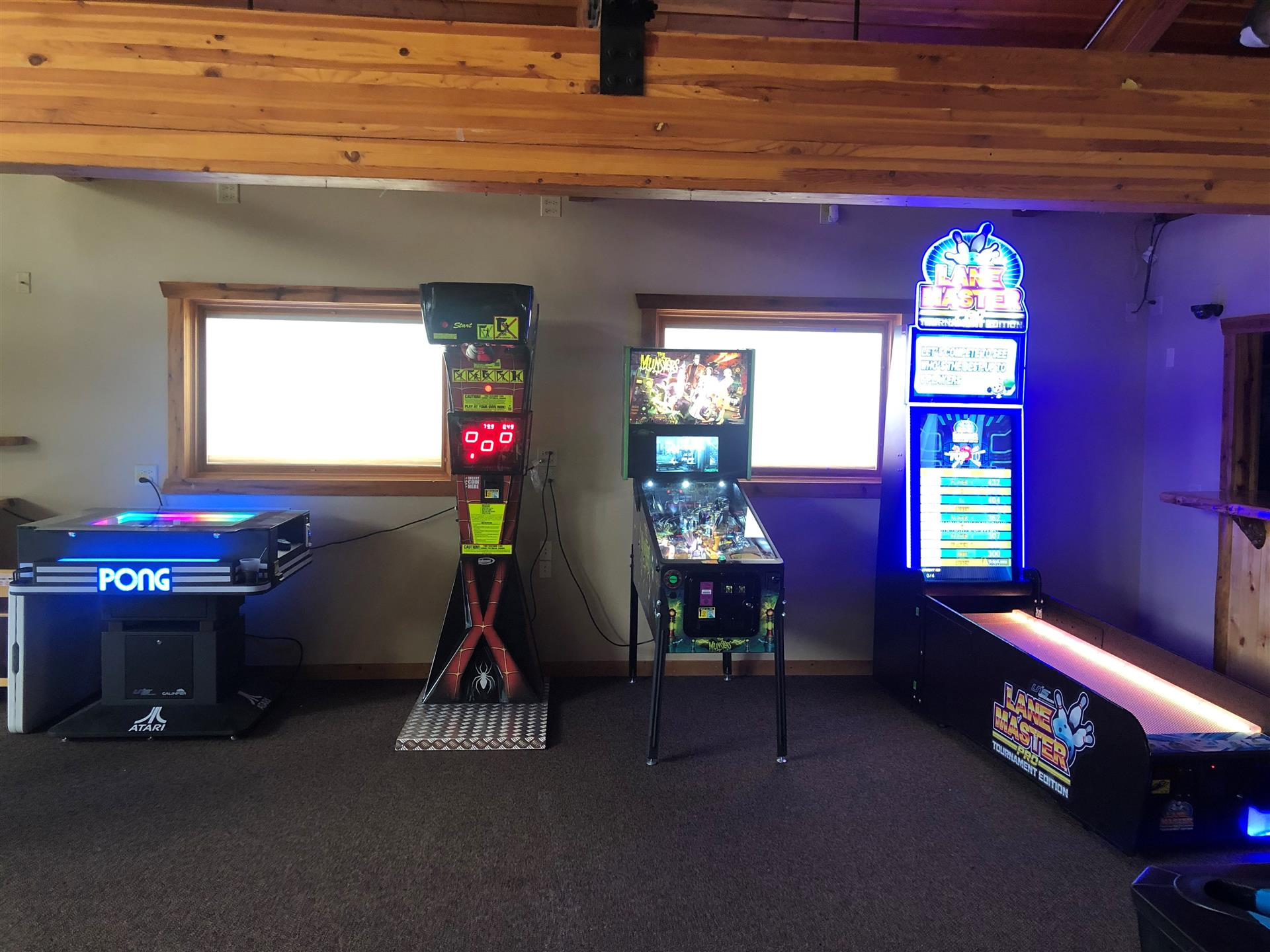 4 arcade games in a room