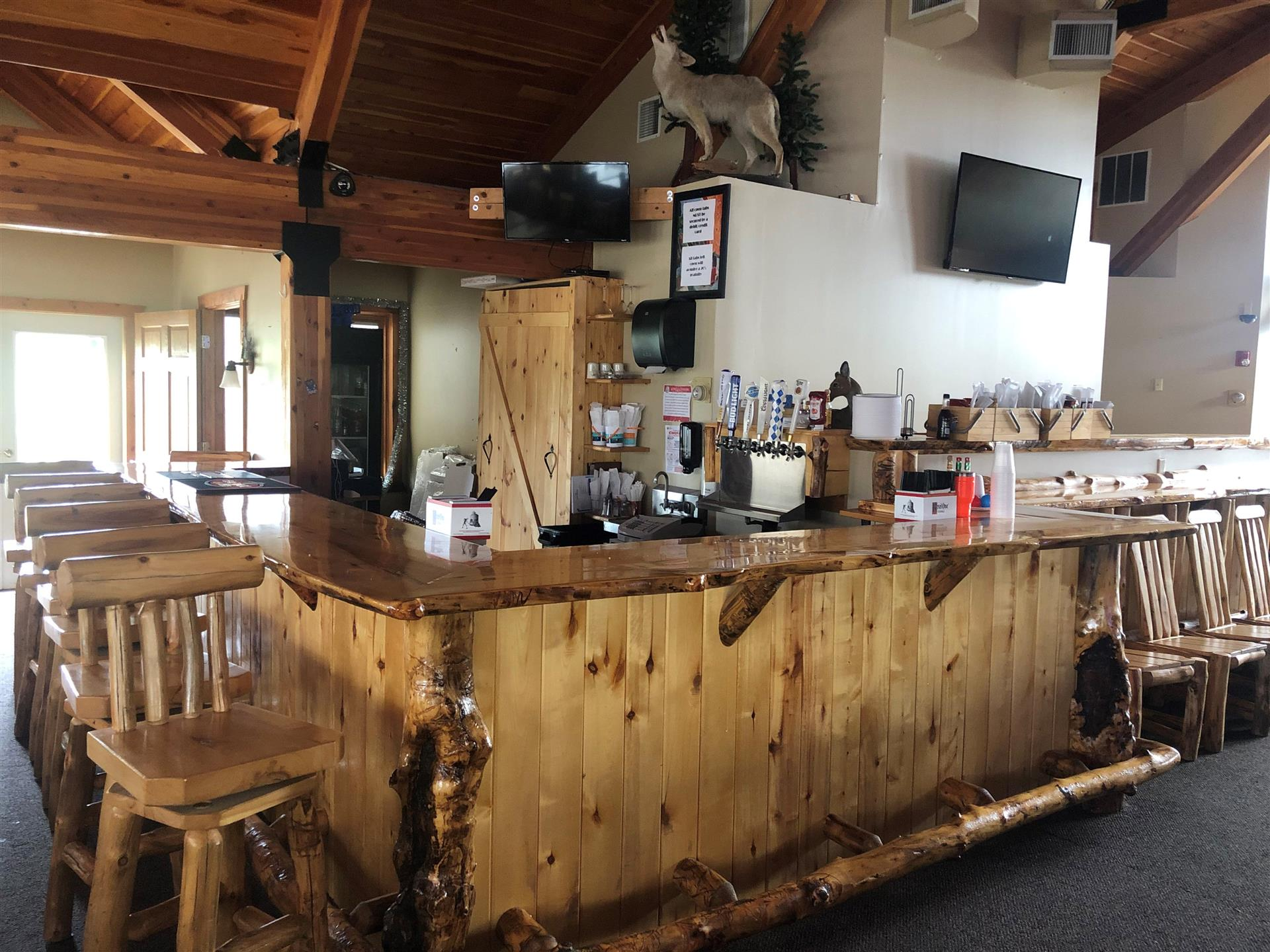 a wooden bar with wooden stools