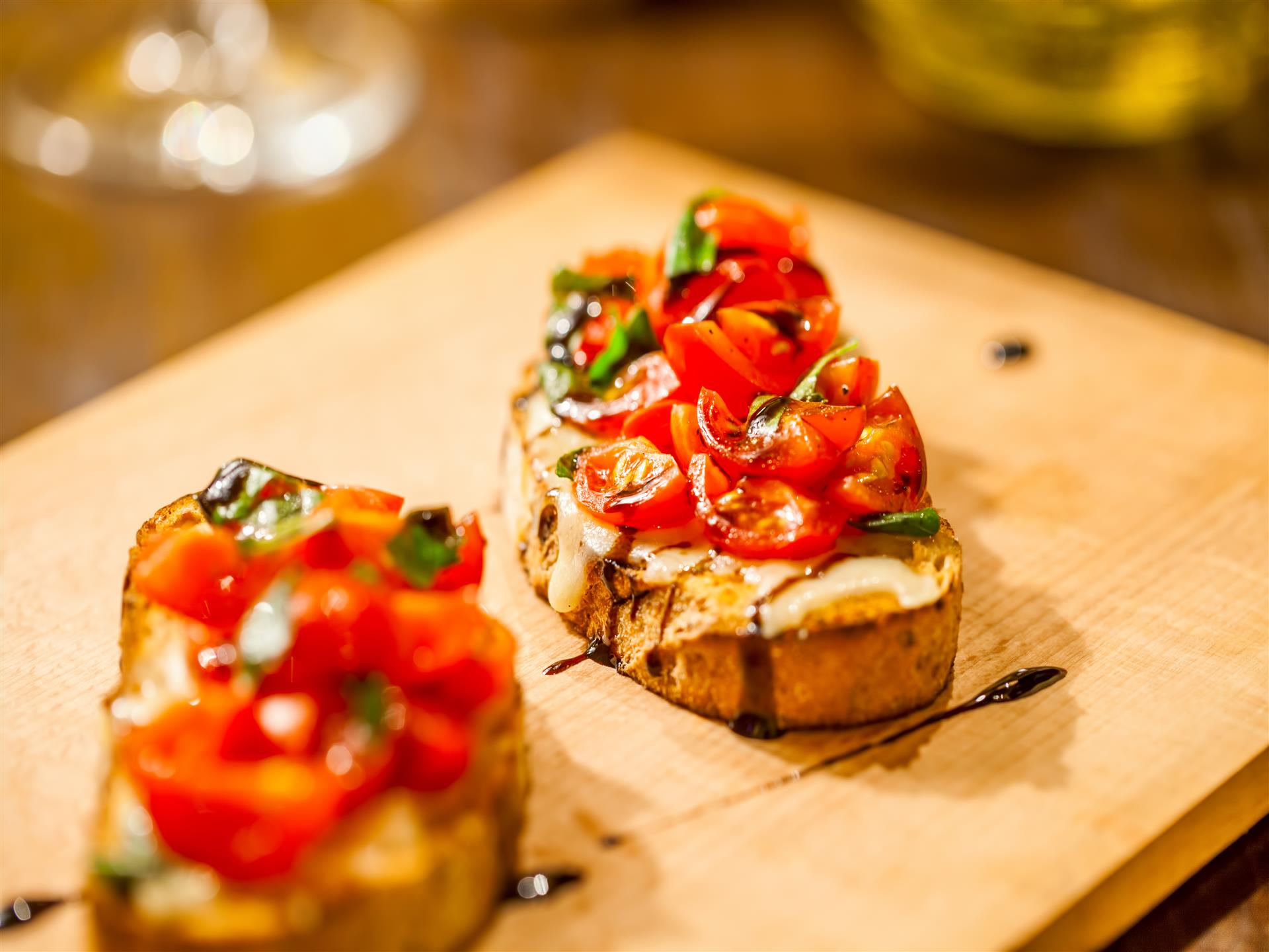 bruschetta with tomatoes on a cutting board