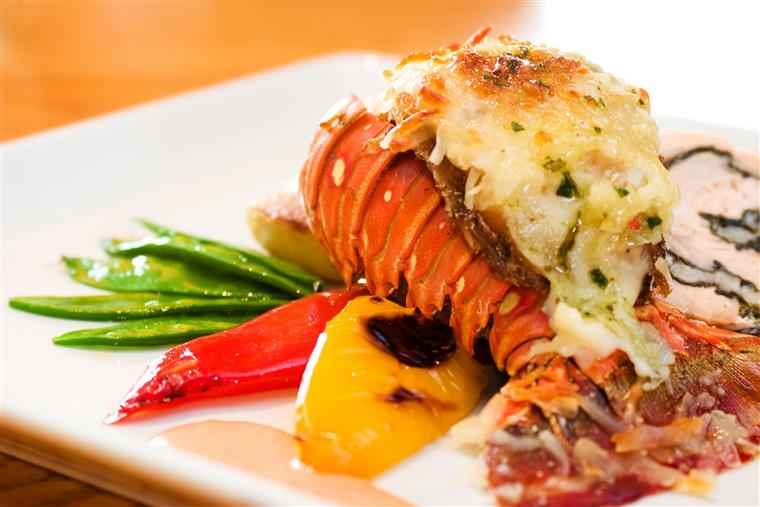 lobster tail with mixed vegetables on a plate