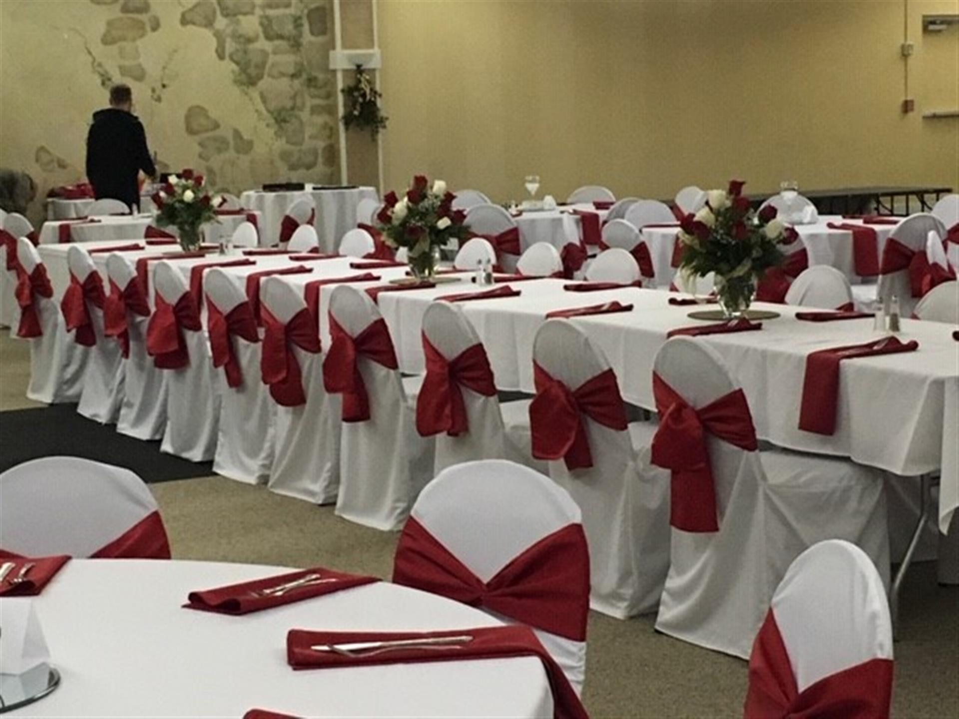 Rectangle table covered in a tablecloth with flower centerpiece  inside Mesenberg Hall