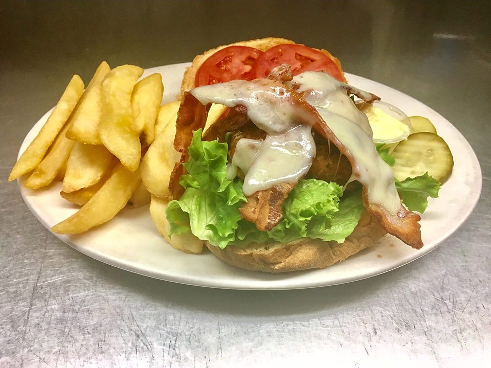 Bacon cheese burger with lettuce, tomato, pickles and French fries