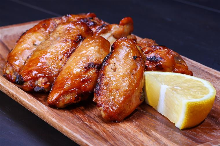 chicken wings with a slice of lemon