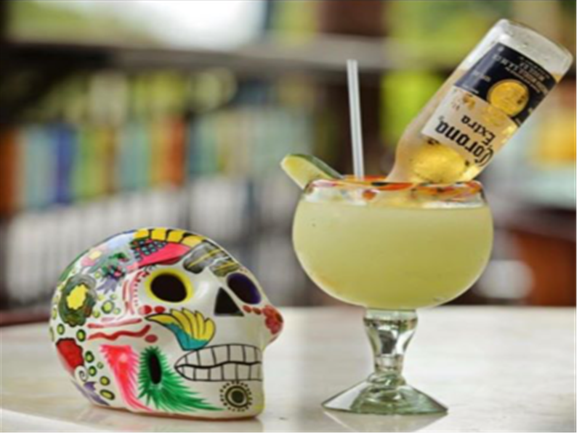 Margarona on a table next to a sugar skull.