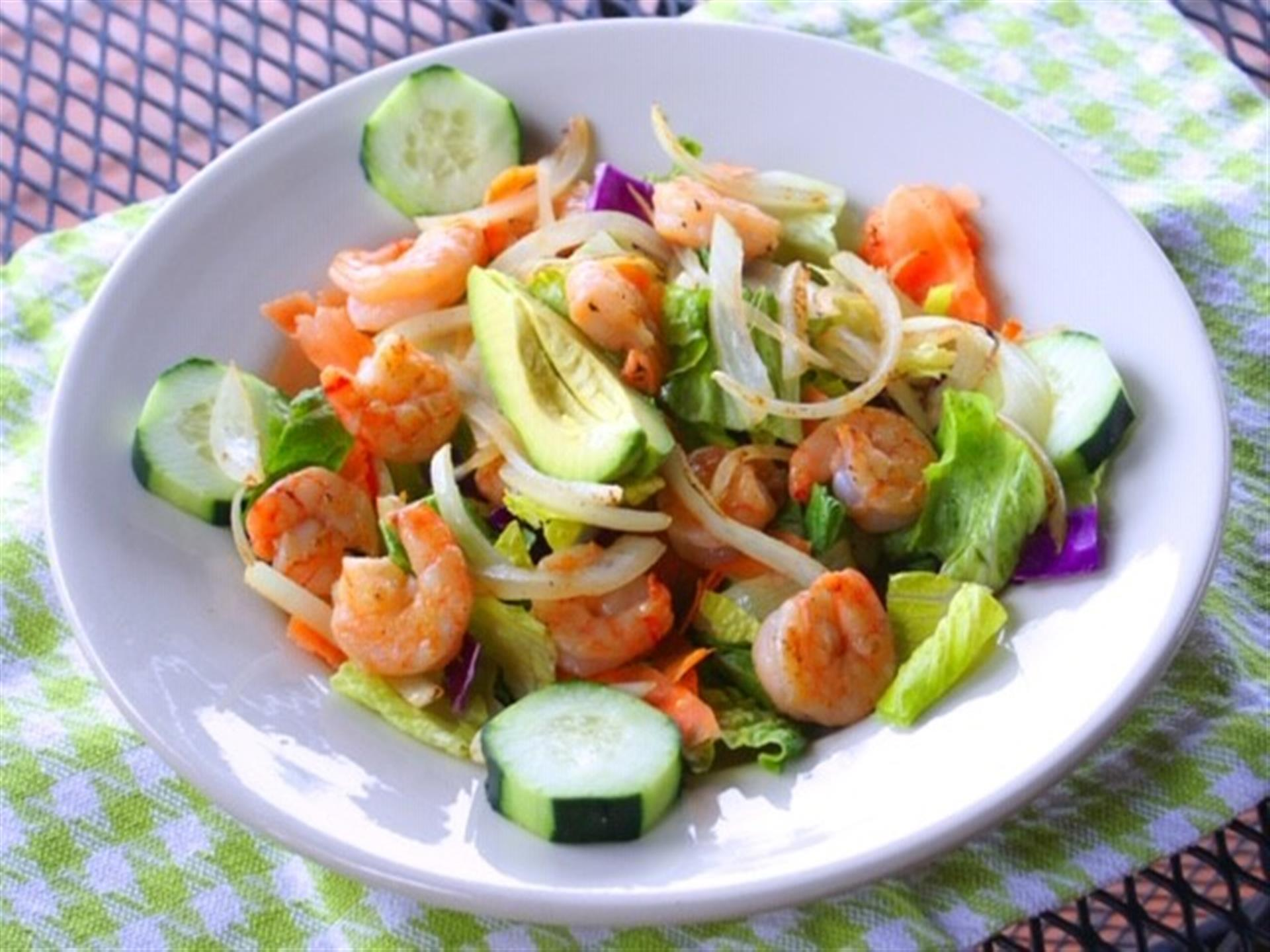 Cancun Salad. A bed of fresh hearts of romaine, cucumbers and fresh avocado slices, topped with grilled shrimp and onions