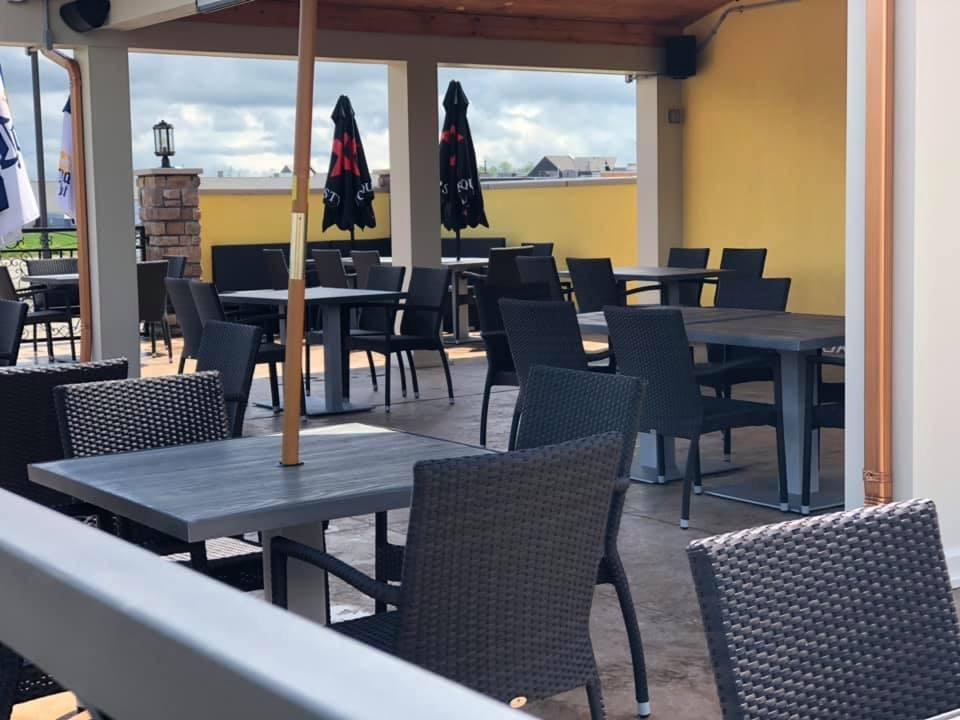 outside patio seating with tables and umbrellas