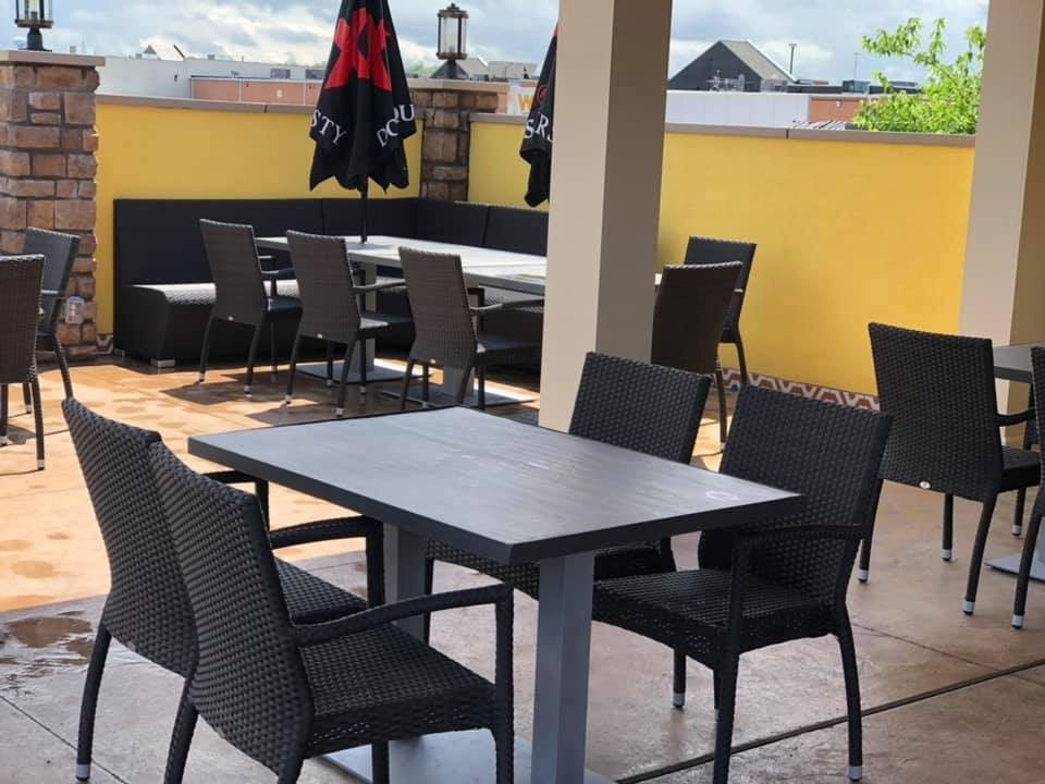 Patio seating outside under the overhang