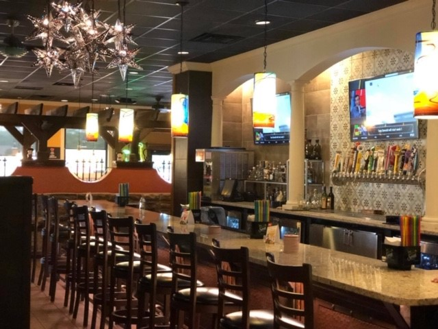 right side of the bar with stools