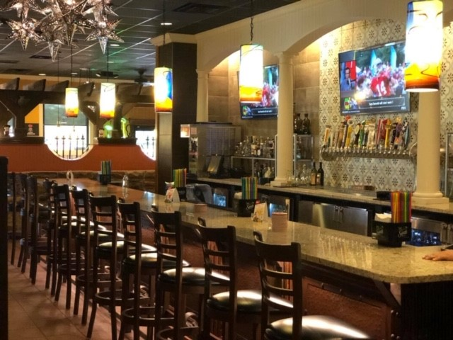 Right side of the bar with bar stools