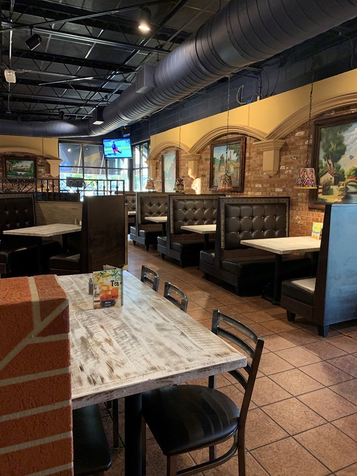 Inside of the restaurants with empty booths and tables