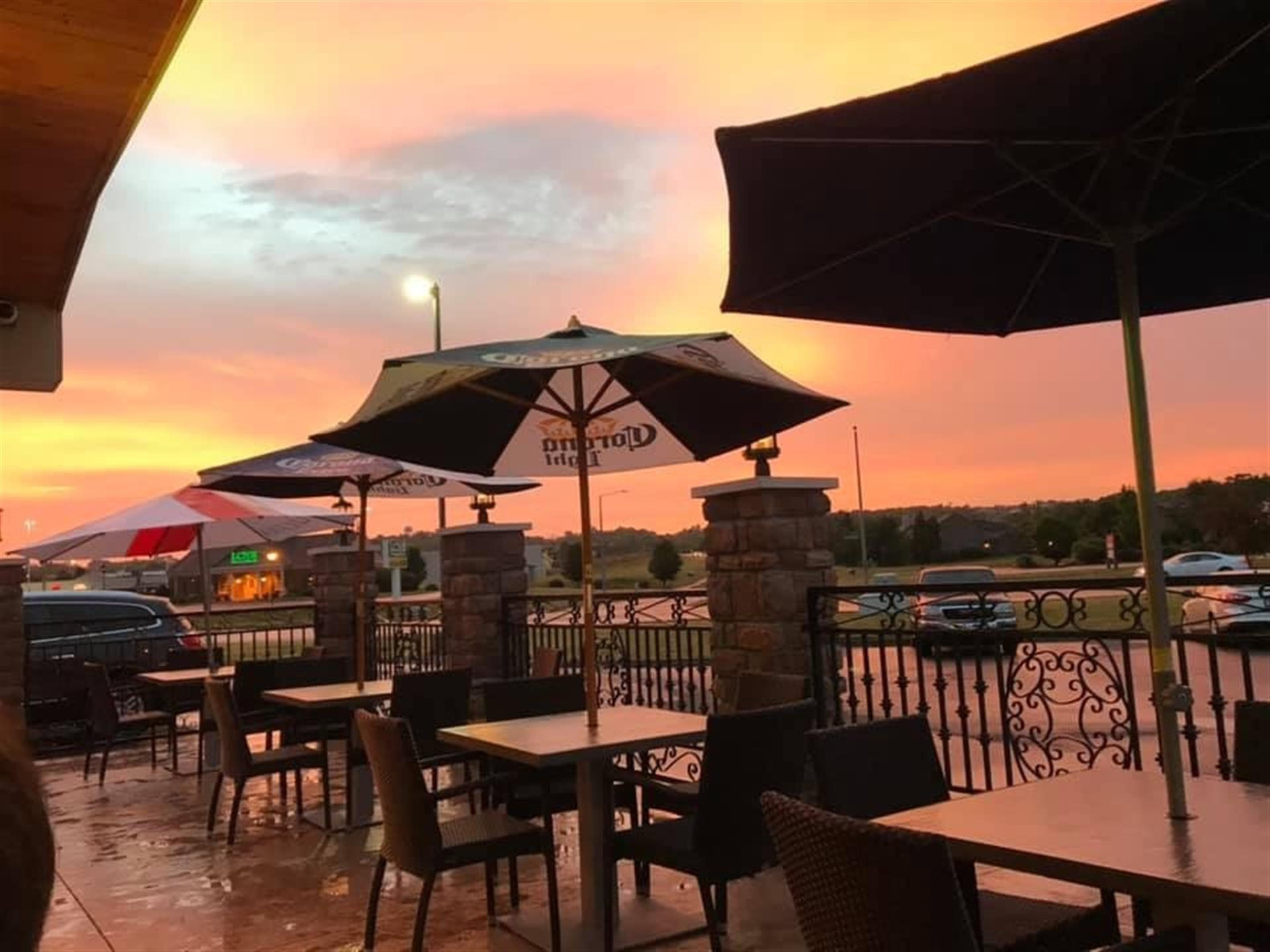 sunset on the outside patio of the restaurant