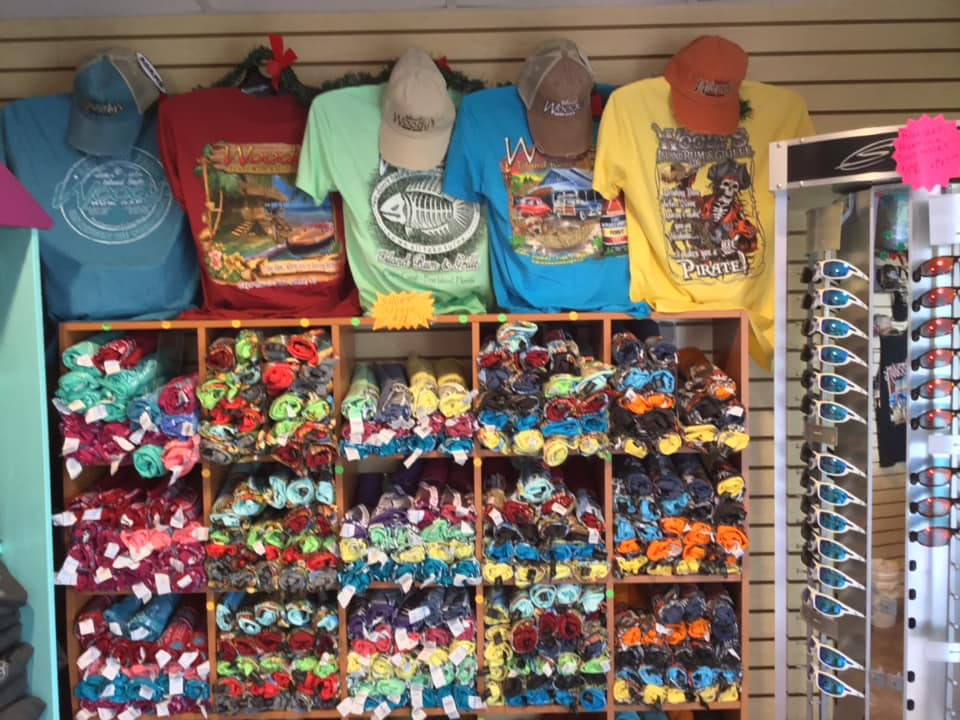 woody's gift shop selling clothing, hats and sunglasses