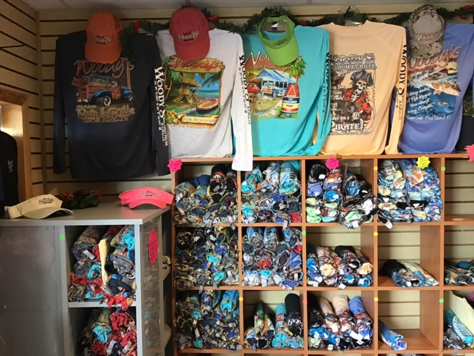 woody's gift shop selling clothing and hats
