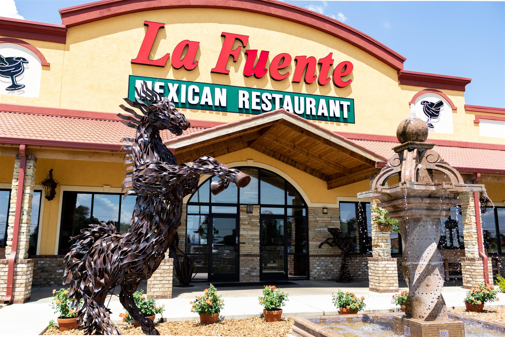 fountain and statue being displayed outside la fuente mexican restaurant