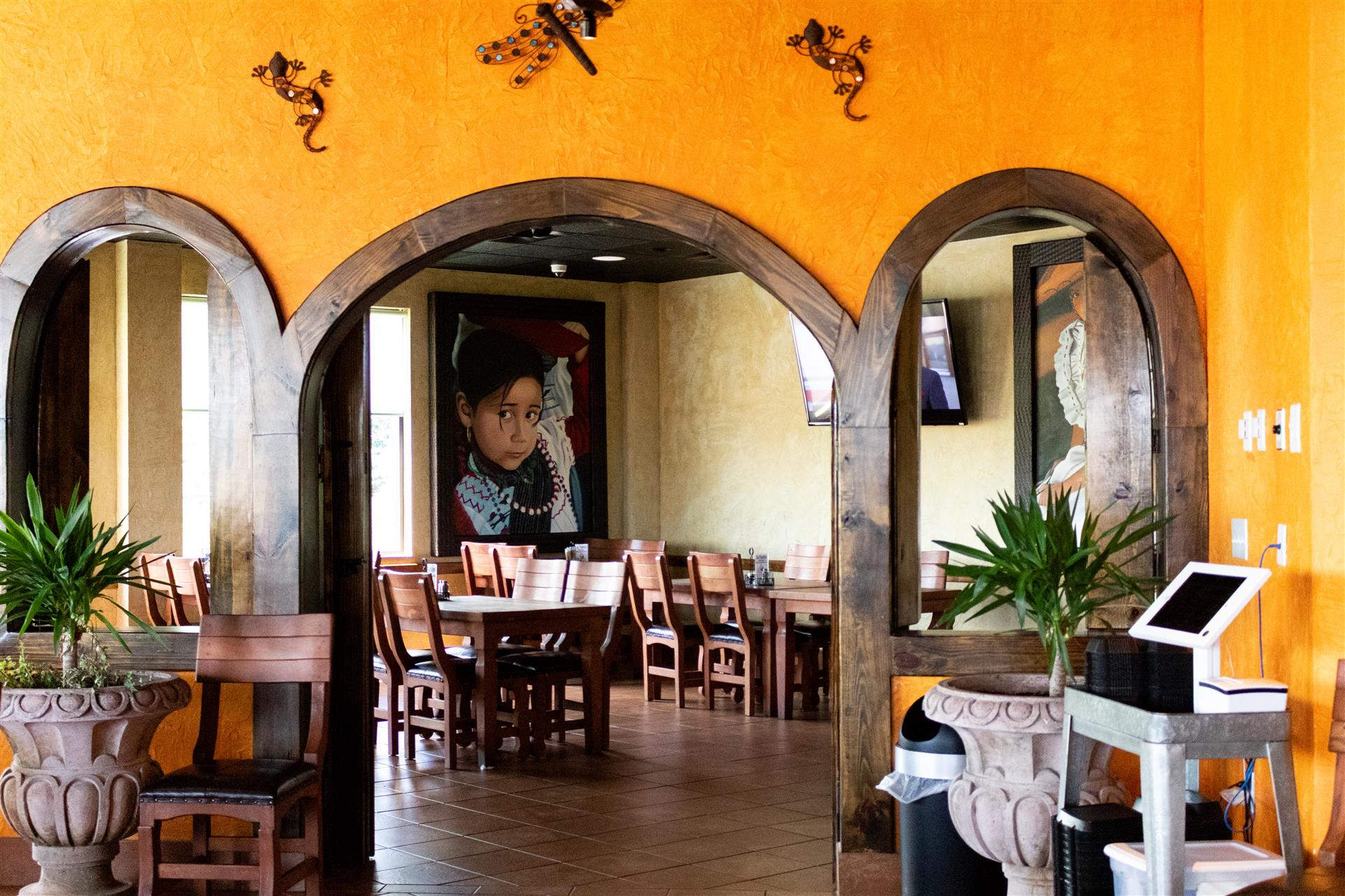 inside the la fuente mexican restaurant showcasing the tables, chairs and decorations on the wall