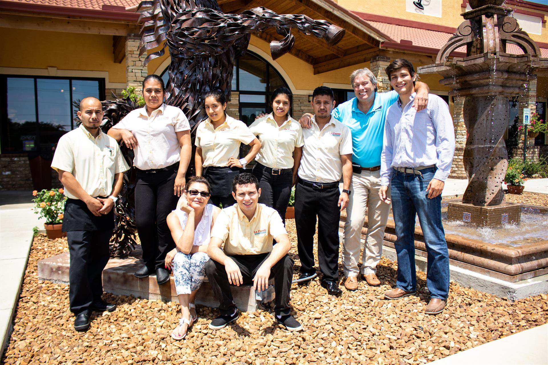 la fuente mexican restaurant staff taking a photo outside the establishment