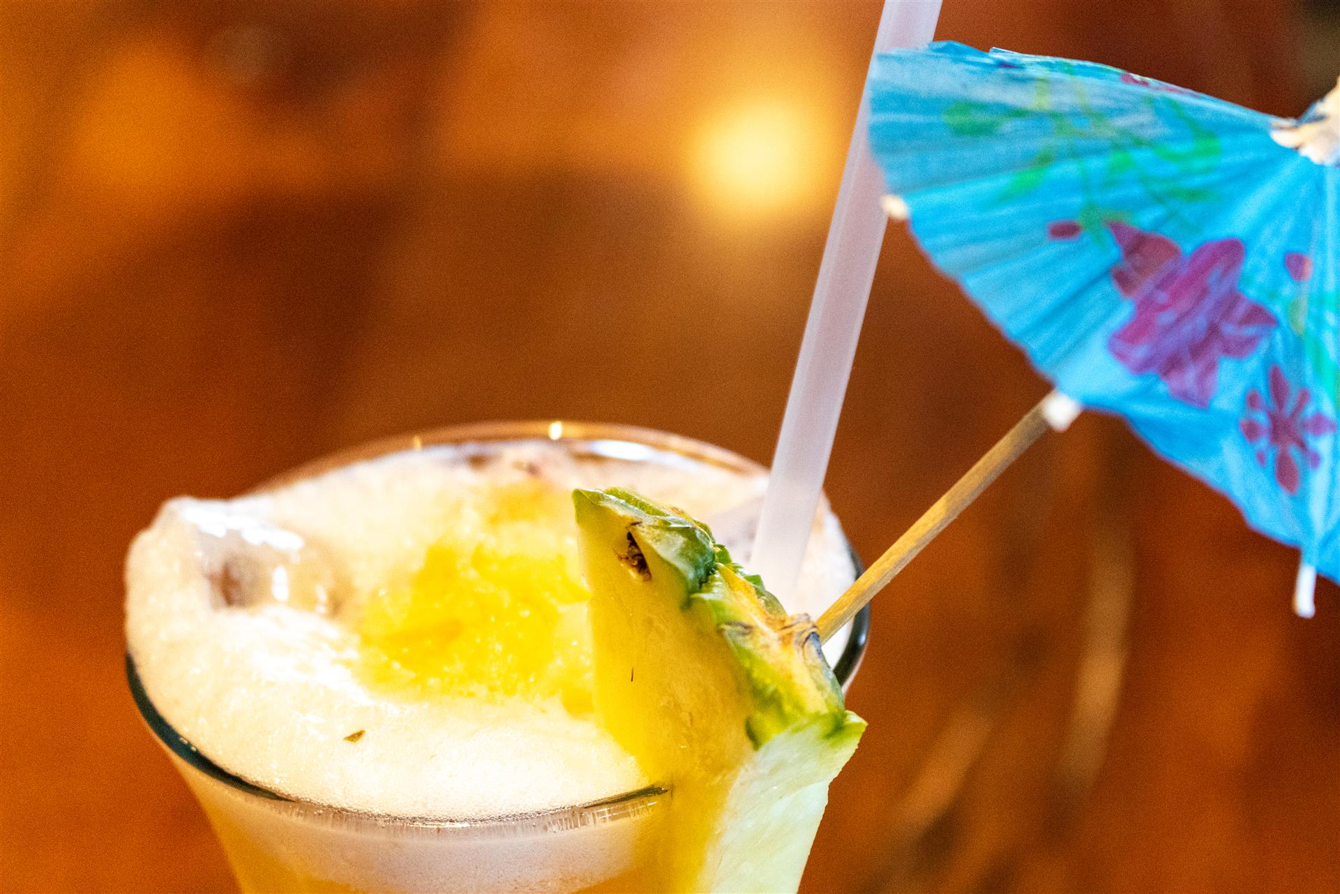 tropical cocktail with pineapple wedge and umbrella