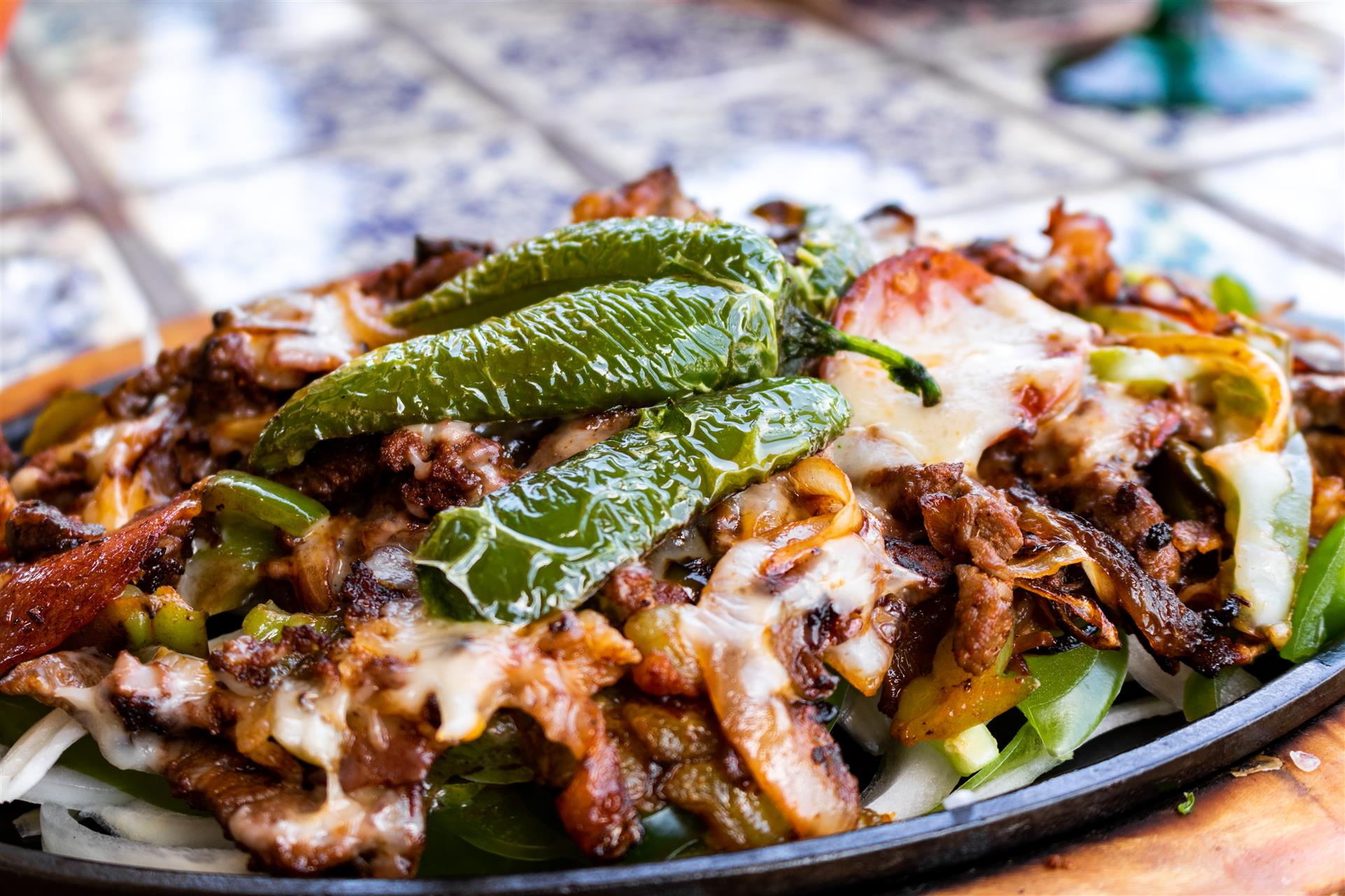 beef skillet with onions, peppers and cheese