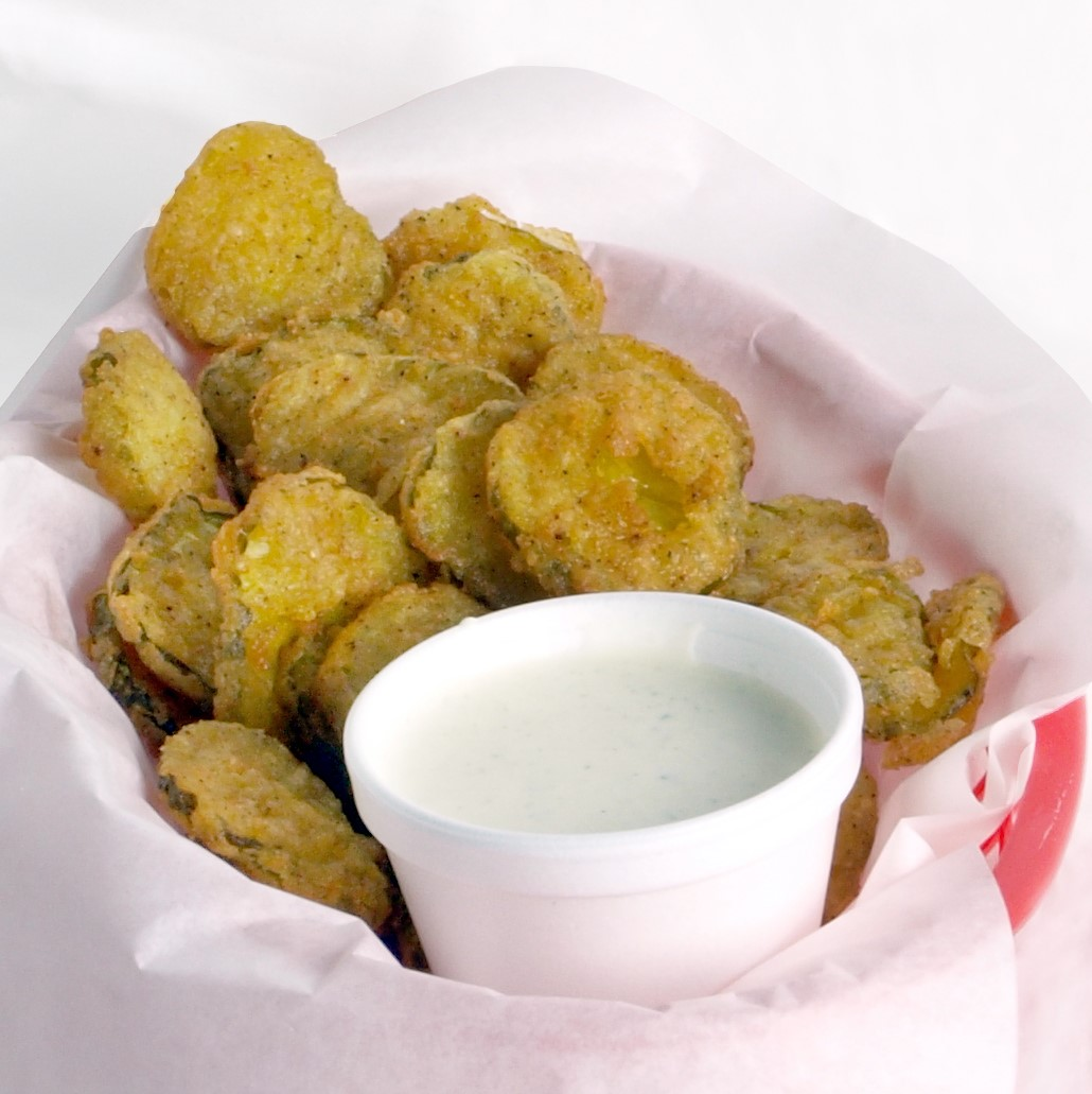 Basket of fried pickles with dipping sauce