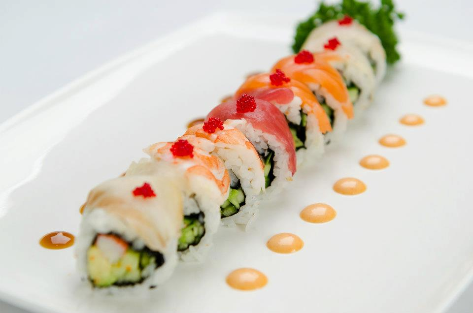 Assorted Dynamite, Ocean, Butterfly, Spicy Tuna Maki, garnished with drips of dipping sauce