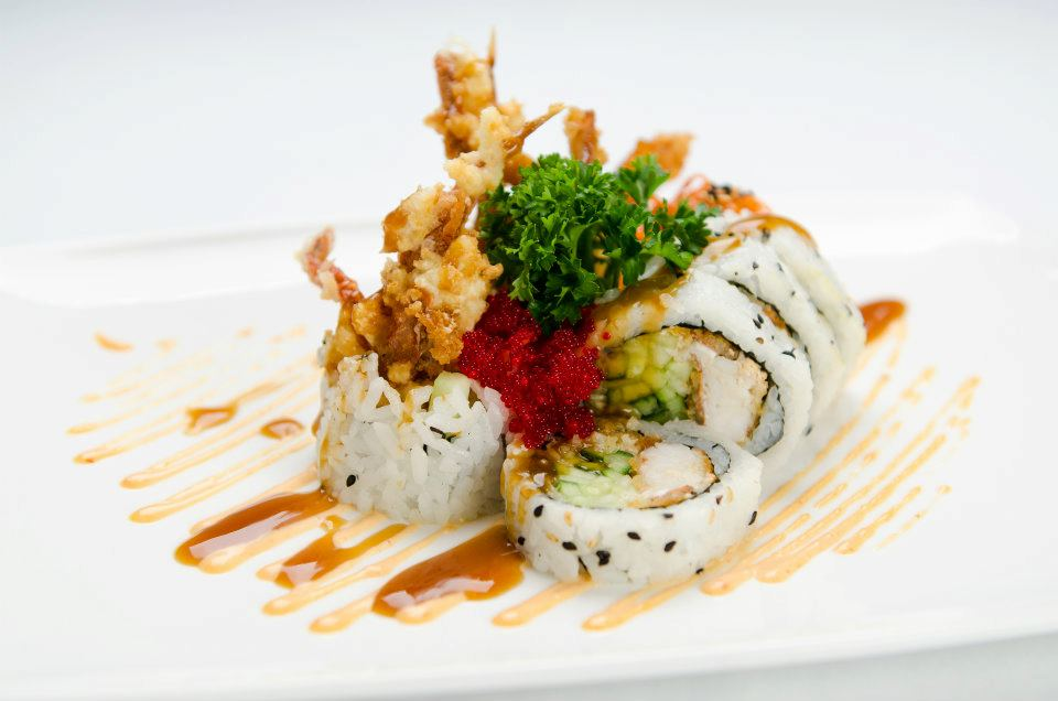 Shanghai roll. Fried soft shell crab, tempura, cucumber, caviar, teriyaki sauce.