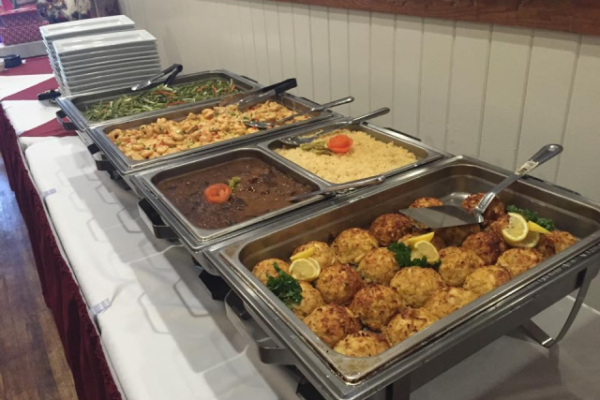 Catering trays with assorted foods on a table-top