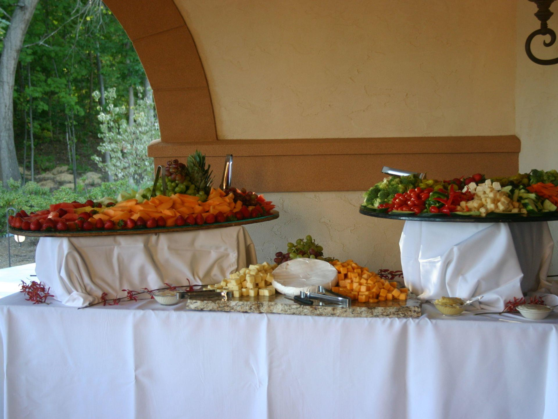 Catering display with assorted fruits, vegetables and cheeses
